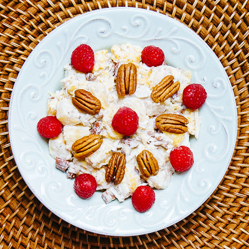 Paleo Ambrosia Salad with pineapple, raspberries, coconut, and pecans | meljoulwan.com