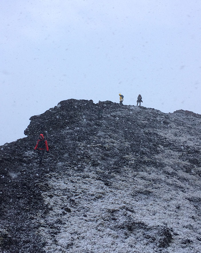 Climbing an extinct volcanic cone in a snowstorm near Reykjavik, Iceland | meljoulwan.com